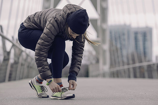 Woman tying running shoes.Woman tying running shoes.