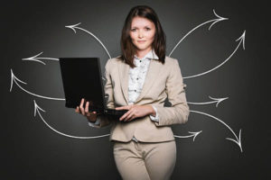 Woman standing with laptop