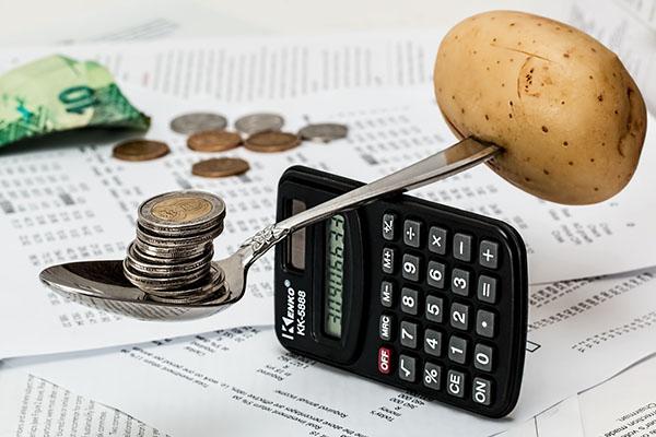 Euros balancing a potato.